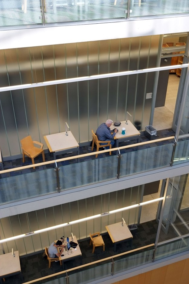individual study carrels on balconies hanging into the atrium