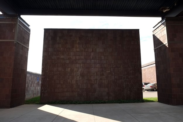 it resembles the monolith in 2001, but it is really just a screen wall hiding the parking lot