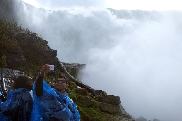 this guy is standing in a dead-end spot which seems to be reserved for selfie-takers